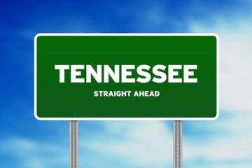 Green road sign reading Tennessee Straight Ahead